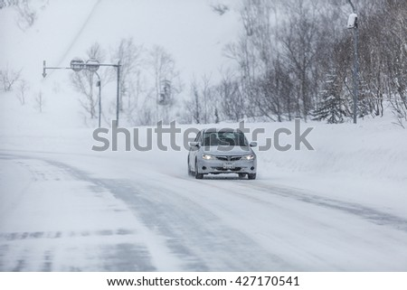 Sapporo, Hokkaido, JAPAN - December 13, 2011: The road is covered with snow on the way from Sapporo city to Niseko in Hokkaido, Japan