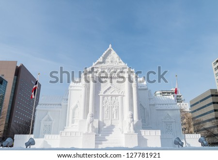 SAPPORO, JAPAN - FEB. 10 : Snow sculpture of Wat Benchamabophit at Sapporo Snow Festival site on February 10, 2013 in Sapporo, Hokkaido, japan. The Festival is held annually at Sapporo Odori Park. - stock photo