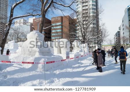SAPPORO, JAPAN - FEB. 5 : Snow sculptures at Sapporo Snow Festival site on February 5, 2013 in Sapporo, Hokkaido, japan. The Festival is held annually at Sapporo Odori Park. - stock photo
