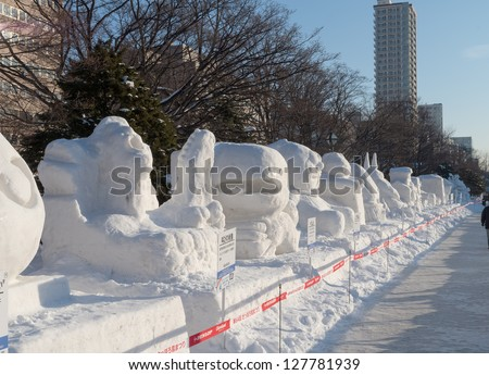 SAPPORO, JAPAN - FEB. 11 : Snow sculptures at Sapporo Snow Festival site on February 11, 2013 in Sapporo, Hokkaido, japan. The Festival is held annually at Sapporo Odori Park. - stock photo