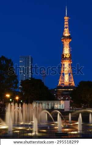 SAPPORO, JAPAN - JUNE. 12 : Night scene of Sapporo TV Tower and the West 3 Fountain on June 12, 2013 in Sapporo, Hokkaido, japan. The Tower and Fountain are located at Sapporo Odori Park. - stock photo