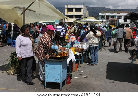 SAQISILI, ECUADOR - AUGUST 5 : At the biggest indian market of South America indian women are selling food, August 5, 2010 in Saqisili, Ecuador