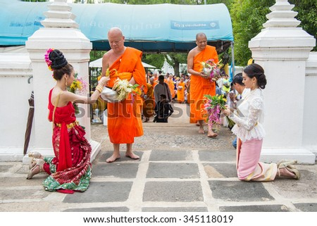 Saraburi,Thailand - July 31 : People giving flower alms to buddhist monks in annual festival of flower alm to buddhist on 31 July 2015 - stock photo