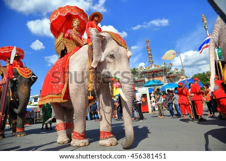 Saraburi, Thailand - July 20, 2016: The parade elephant is decorated with many different kinds of flowers during Buddhist lent ceremony at Phrabuddhabat temple on 20th July 2016 in Saraburi, Thailand. - stock photo