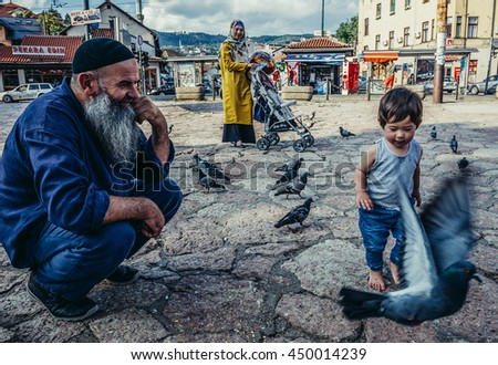 Sarajevo, Bosnia and Herzegovina - August 23, 2015. Bosnian family at old bazaar and the historical and cultural center of the Sarajevo called Bascarsija