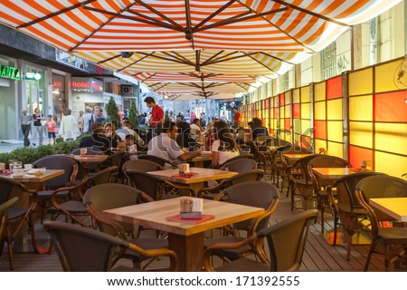 SARAJEVO, BOSNIA AND HERZEGOVINA - AUGUST 13, 2012: Locals and tourists enjoy drinks on cafe terrace. - stock photo