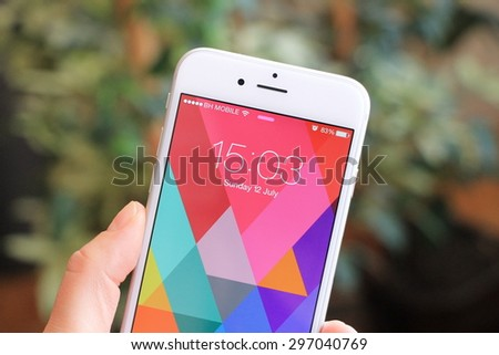 SARAJEVO , BOSNIA AND HERZEGOVINA - JULY 12 , 2015: New gray iPhone 6 with colorful screen in woman's hand. iPhone 6 was created and developed by the Apple inc. - stock photo