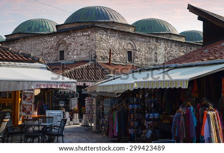 Sarajevo, Bosnia and Herzegovina- 7 July, 2014: Pedestrian Market area of Bascarsija dzamija Mosque (the dome) in sunset, here is old market-place, historical and cultural centre of Sarajevo City. - stock photo