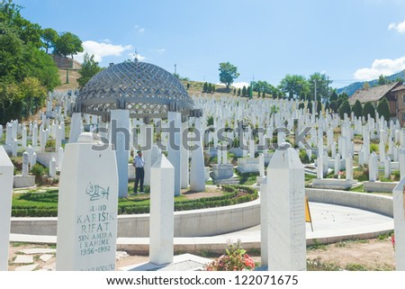 SARAJEVO, BOSNIA - AUGUST 12, 2012: Muslim graveyard under blue sky in Sarajevo on August 12, 2012 in Sarajevo, Bosnia. The Islamic religion is one of the three major religion in Bosnia.