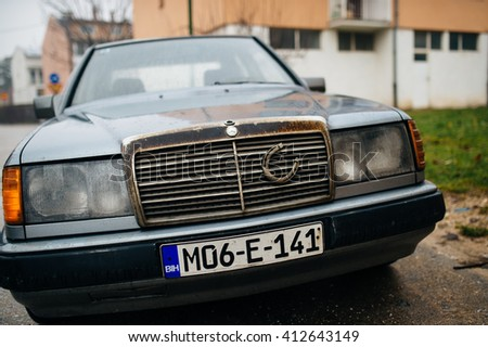 SARAJEVO, BOSNIA - HERZOGOVINA - 12 january 2015 closeup wideangle shot of an Old Mercedes with a lucky stirrup in the street of Sarajevo, Bosnia and Herzegovina
