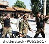 SARAJEVO, BOSNIA - JUNE 3: Bosnian army troops of the 10th Mountain Brigade run through the streets during fierce fighting in Sarajevo, Bosnia, on Thursday, June 3, 1993. - stock photo