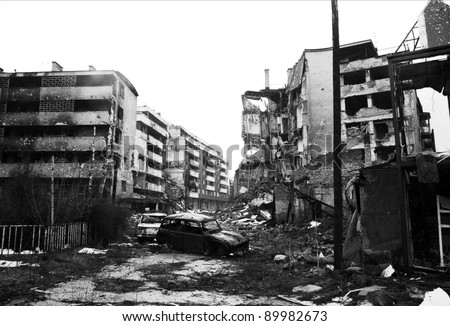 SARAJEVO, BOSNIA - MAR 15: Crushed cars and the  debris of war litter the destroyed streets of  Sarajevo, Bosnia, on Friday, March 15, 1996. - stock photo
