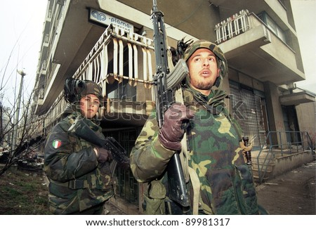 SARAJEVO, BOSNIA - MAR 18: Italian army troops, in Bosnia as part of the United Nations' UNPROFOR, patrol the streets of Sarajevo, Bosnia, on Monday, March 18, 1996. - stock photo
