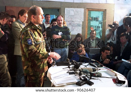SARAJEVO, BOSNIA - SEPT 1: A British Army press officer the United Nations Peace Keeping operation in Bosnia, speaks with with the international press at  the daily briefing in Sarajevo, Bosnia, on Wednesday, September 1, 1993 - stock photo
