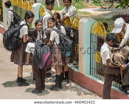 SARANATH,INDIA-JULY 19, 2016.:The unidentified Indian students standing at the school gate. in Thai Saranath school on July 19,2016 in Pelling,India.