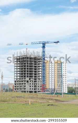 SARANSK, RUSSIA - JULY 19, 2015: Construction crane and concrete building construction.