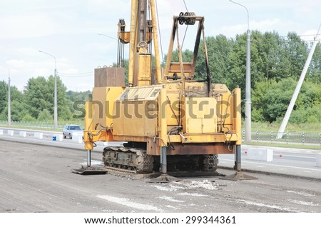 SARANSK, RUSSIA - JULY 19, 2015: Pile driver stay on the road.
