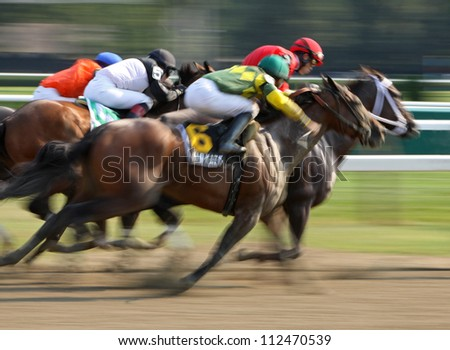 "SARATOGA SPRINGS - AUG 31: Jockey Jose Lezcano and ""Kid Katge"" surge down the outside to finish second in The Big Bambu Stakes at Saratoga Race Course on Aug 31, 2012 in Saratoga Springs, NY. - stock photo"