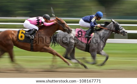 "SARATOGA SPRINGS - JUL 20: Javier Castellano and ""Book Review"" (6) surge down the stretch to ultimately overtake Jose Lezcano and ""Ullapool"" & win the 4th race on Jul 20, 2012 in Saratoga Springs, NY. - stock photo"