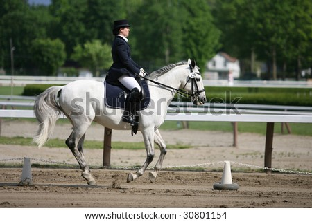 SARATOGA SPRINGS - MAY 23: Ann Savola competes on Rubi in the Open Division at the Dressage May 23, 2009 in Saratoga Springs, NY.