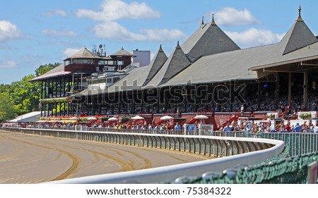 SARATOGA SPRINGS, NY - AUG 27, 2010: Historic Saratoga Race Course fills up with fans on Travers Day Weekend, Aug 27, 2010 in Saratoga Springs, New York. - stock photo