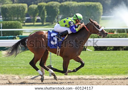 SARATOGA SPRINGS, NY - AUG 29: Jockey Miguel Mena pilots 2-year-old filly Ausable Chasm to her first win at Saratoga Race Course on Aug 29, 2010 in Saratoga Springs, NY. - stock photo