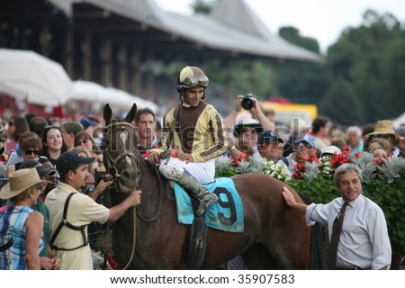 "SARATOGA SPRINGS, NY- AUGUST 24: Alan Garcia aboard ""Privacy"" in the winners circle after the 4th race at Saratoga Race Track, August 24, 2009 in Saratoga Springs, NY."