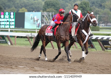 SARATOGA SPRINGS, NY - AUGUST 25:Allan Garcia aboard Willy Beamin in the post parade for the Grade 1 Kings Bishop Stakes on August 25, 2012 Saratoga Springs, New York