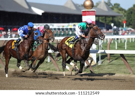 SARATOGA SPRINGS, NY - AUGUST 23: Close up racing action in the seventh race at the clubhouse turn on August 23, 2012 Saratoga Springs, New York - stock photo