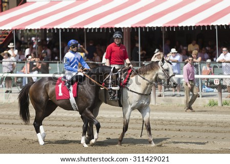 SARATOGA SPRINGS, NY - August 29, 2015: #1 Condominium ridden by Luis Saez before the 2nd race on Travers Day at Historic Saratoga Race Course on August 29, 2015 Saratoga Springs, New York - stock photo