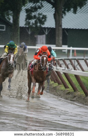 "SARATOGA SPRINGS, NY- AUGUST 29: ""Devil May Care"" with John Velazquez aboard has the lead at the top of the stretch in the 2nd race at Saratoga Race Track, August 29, 2009 in Saratoga Springs, NY. - stock photo"