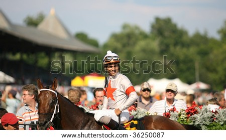 "SARATOGA SPRINGS, NY- AUGUST 24: Shaun Bridgmohan aboard ""Inca King"" in the winners circle after the 7th race at Saratoga Race Track, August 24, 2009 in Saratoga Springs, NY. - stock photo"