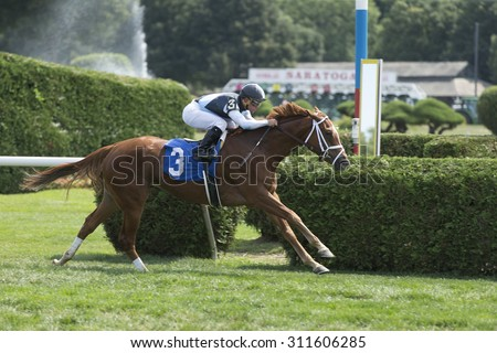 SARATOGA SPRINGS, NY - August 29, 2015: #3 Tango Time ridden by Javier Castellano wins the 3nd race on Travers Day at Historic Saratoga Race Course on August 29, 2015 Saratoga Springs, New York - stock photo