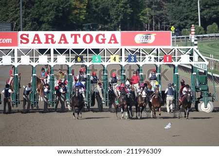 SARATOGA SPRINGS, NY - August 18, 2014: The field breaks in the First Running of the Summer Colony Stakes at Historic Saratoga Race Course on August 18, 2014 Saratoga Springs, New York - stock photo