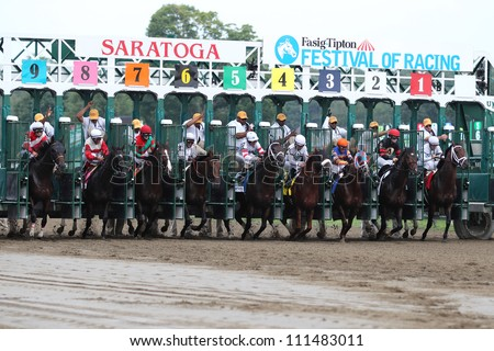 Saratoga Springs NY - AUGUST 4: The field leaves the gate at the start of the Whitney Invitational on August 4, 2012 Saratoga Springs, New York - stock photo