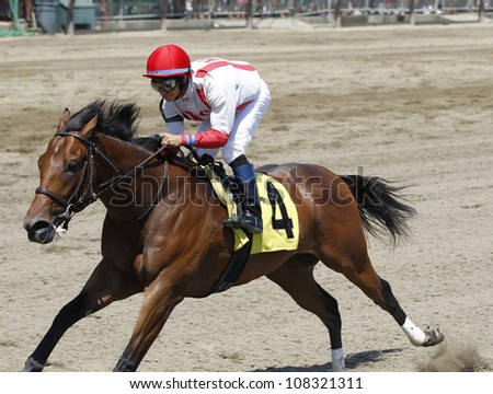 """SARATOGA SPRINGS, NY - JULY 21: """"Spurious Precision"""" with Alan Garcia aboard wins the 2nd race on July 21, 2012 Saratoga Springs, New York - stock photo"""