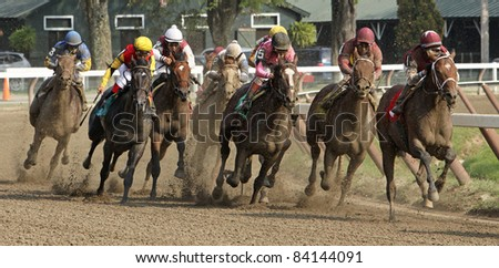 "SARATOGA SPRINGS, NY -SEPT 3: ""Alpha"", (far right with red saddle cloth), wins his first race at Saratoga Race Course on Sept 3, 2011 in Saratoga Springs, NY. Alan Garcia up."