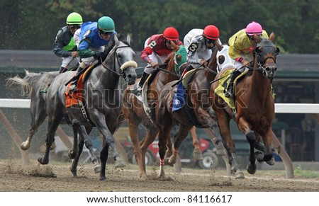 "SARATOGA SPRINGS, NY - SEPT 3: Jockey Jeremy Rose (pink cap) pilots ""SouthbeachSandy"" to victory in an allowance race at Saratoga Race Course on Sept 4, 2011 in Saratoga Springs, NY. - stock photo"
