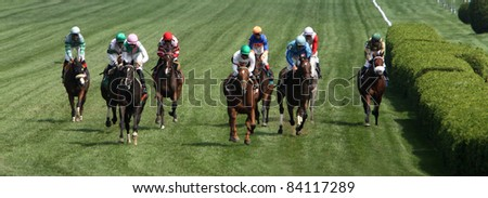SARATOGA SPRINGS, NY -SEPT 3: Rajiv Maragh (green cap, center) guides Sugar Again to victory in the Paris Opera Stakes at Saratoga Race Course on Sept 3, 2011 in Saratoga Springs, NY. - stock photo