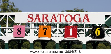 SARATOGA SPRINGS, NY- SEPT 5: Top of the Starting gate against the clear morning sky on Woodward day at Saratoga Race Track, September 5, 2009 in Saratoga Springs, NY. - stock photo