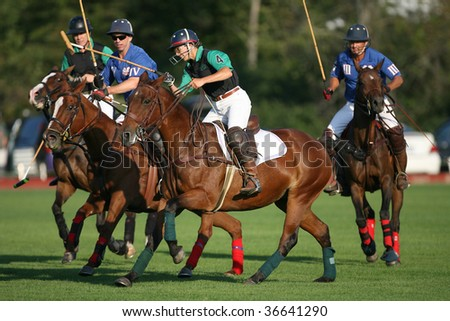 SARATOGA SPRINGS - SEPTEMBER 4 : Shamrock and Bloomfield players fight for the ball at Saratoga Polo Club September 4, 2009 in Saratoga Springs, NY.