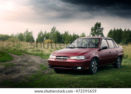 Saratov, Russia - August 28, 2014: Car Daewoo Nexia stay on countryside road at daytime