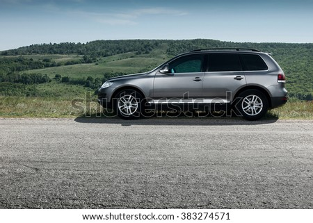 Saratov, Russia - May 18, 2014: Premium car Volkswagen Touareg stay on asphalt road near mountain at daytime
