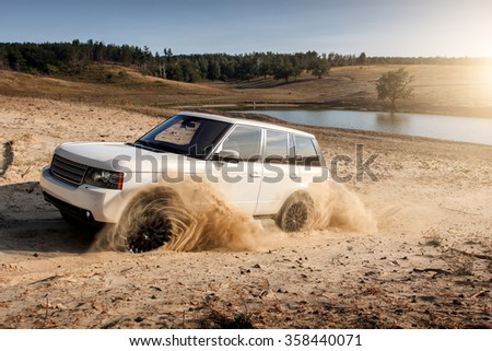 Saratov, Russia - September 1, 2014: Car Land Rover Range Rover dirty sand burnout drive off-road - stock photo