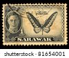 SARAWAK - CIRCA 1940: A stamp printed in the Sarawak shows portrait of King George VI,  Troides Brookiana (Butterfly), Circa 1940 - stock photo