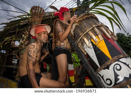 SARAWAK, MALAYSIA: JUNE 1, 2014: Musicians from the Bidayuh tribe, an indigenous native people of Borneo plays the drums in a street parade celebrating thanksgiving day, known as the Gawai festival. - stock photo