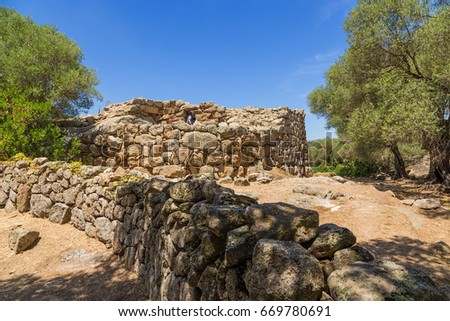 SARDINIA, ITALY - JUL 4, 2016: Arzachena: Ruins of the megalithic prehistoric fortress of Nuraghe Albucci and its surrounding villages, around 1600 BC