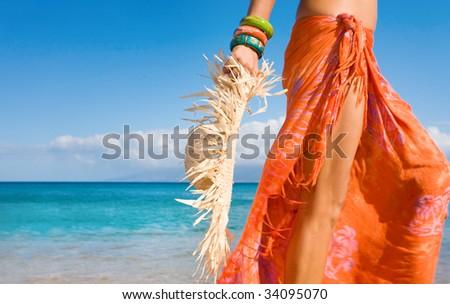 sarong woman closeup hat beach - stock photo