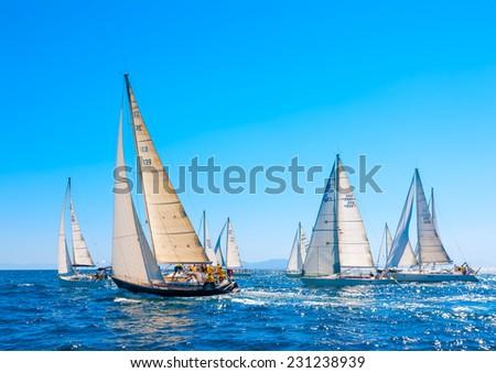 SARONIC GULF, GREECE - MAY 31, 2013: Racing sailing boats during a regatta at Saronic gulf near Athens Greece on May 31, 2013 - stock photo