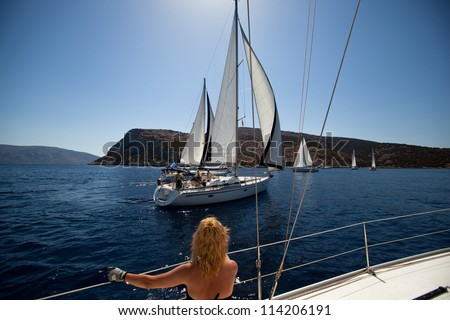 "SARONIC GULF, GREECE - SEPTEMBER 24: Boats Competitors During of sailing regatta ""Viva Greece 2012"" on September 24, 2012 on Saronic Gulf, Greece. - stock photo"